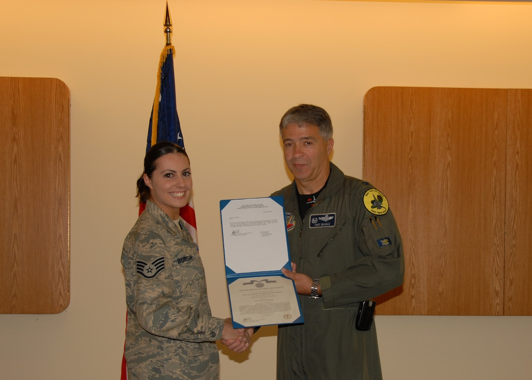 SSgt Heather J. Borisov, 174 FW Command Post Journeymen is awarded the U.S. Air Force Achievement Medal by 174 FW Commander Anthony B. Basile during a ceremony at Hancock Field Air National Guard Base on Saturday the Third of May.