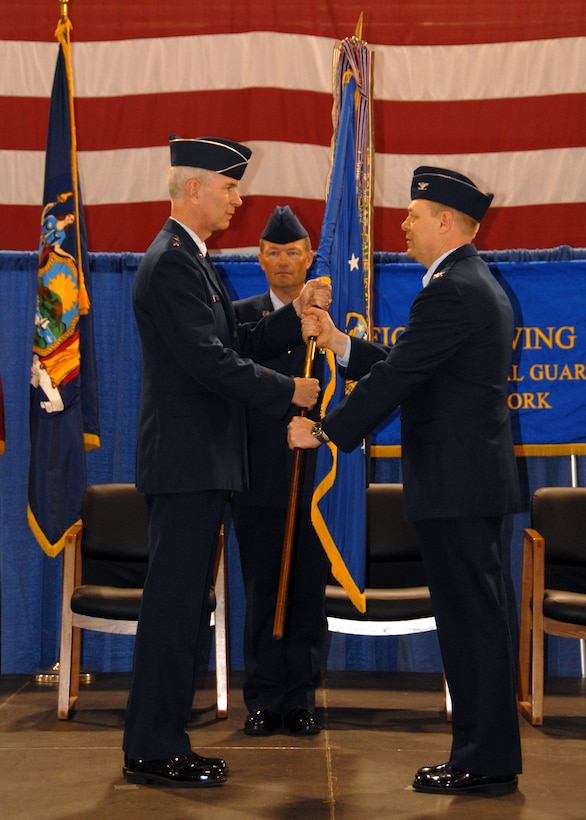 Col. Kevin W. Bradley accepts command of the 174 FW from Maj. Gen. Robert A. Knauff.