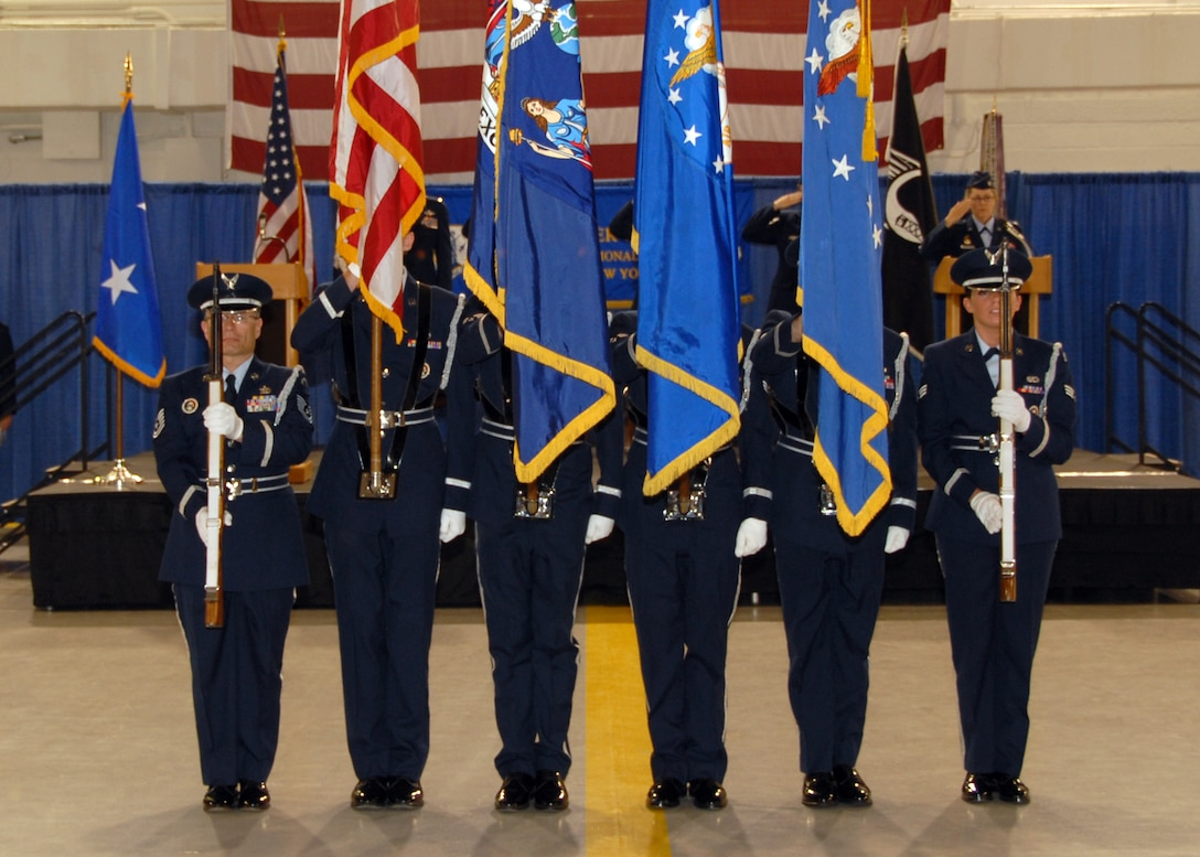 The Hancock Field Base Honor Guard team presents the colors during the 174 FW Change of Command Ceremony.