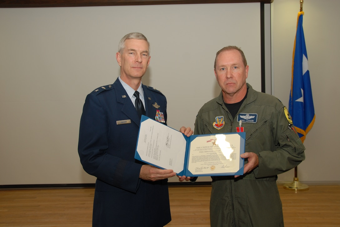 Maj Gen Robert A. Knauff, NY Air National Guard Commander was on hand to award the bronze star to Lt. Col. Kurt R. Larson, 174th Fighter Wing RC-26B Counterdrug Program Manager during a ceremony on Sunday the fourth of May at Hancock Field Air National Guard Base .