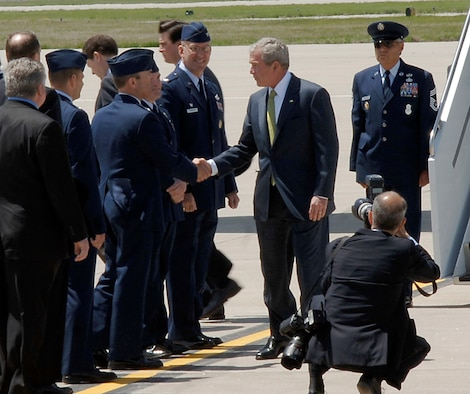 Col. William Cahoon, 931st Air Refueling Group Commander, greets President George Bush at McConnell Air Force Base, Kan., on May 4.  The president was in Kansas to visit Greensburg, Kan., a town west of McConnell AFB that was destroyed by a tornado a year prior. Airmen from throughout the 931st also greeted the president, who took time to shake many of their hands.