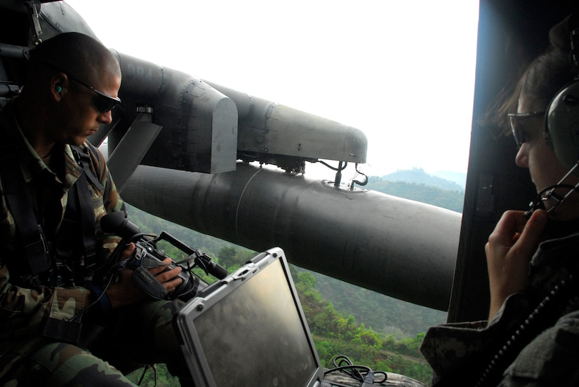 From inside a Joint Task Force-Bravo UH-60 Blackhawk helicopter, Air Force Tech. Sgt. Mike Vaughn and Army Capt. Sarah Williams, JTF-Bravo civil engineers, use the Automated Route Reconnaissance Kit's from gyroscope, global positioning satellite technology, digital video camera and touch-screen computer to capture imagery for use in the disaster exercise Aliadas Humanitarias 2008, a regional disaster relief exercise involving military and civilian agencies occurring here May 5-15.  (U.S. Air Force photo by Tech. Sgt. William Farrow)