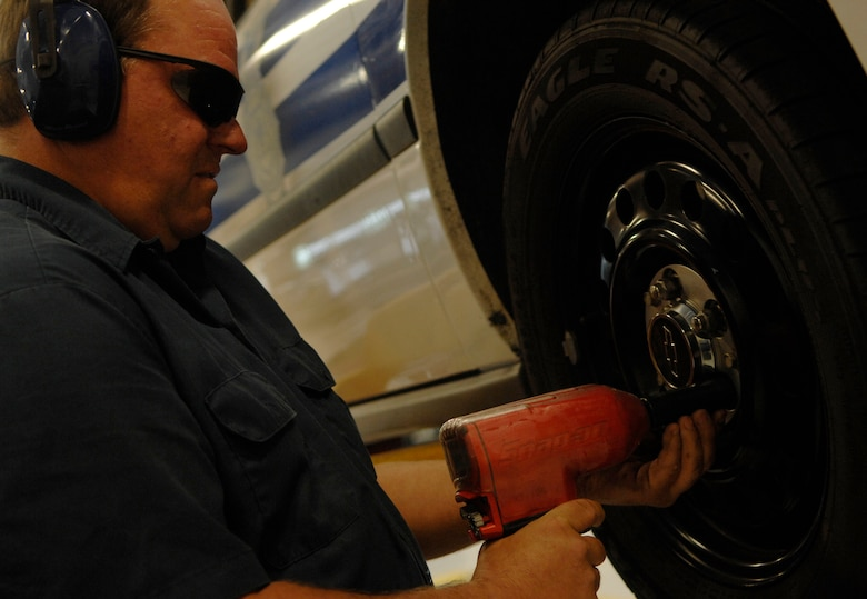 MOODY AIR FORCE BASE, Ga. --  John Butler, 23rd Logistics Readiness Squadron heavy mobile mechanic, removes a tire's lug nuts here May 6. Mr. Butler is preparing to inspect the vehicle's brakes. (U.S. Air Force photo by Senior Airman Gina Chiaverotti)