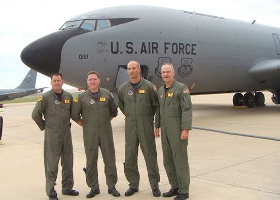 "Members of ""Okie 41"" were recently awarded by the Air Force Reserve Command for their efforts providing aerial refueling support during a search and rescue effort for a downed F-16 pilot in 2007.  The crew pictured are, left to right, Chief Master Sgt. Steven Robinson, Capt. Jeffrey Milburn, Maj. Michael Remualdo, and Col. Randall Guthrie. The crew was presented with the Command's Aviation Well Done Award by AFRC Commander Lt. General John Bradley on May 4."