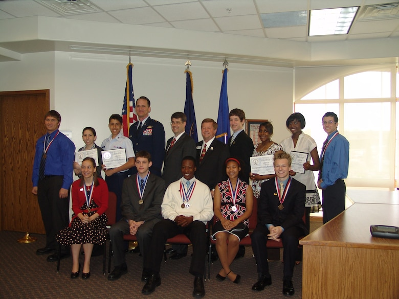 Front Row (left to right) Laura Van Epps, Colin Sorensen, Wayne Banks, Tonni Blount and Matthew Armistead. Back Row (left to right) Matthew Bashus, Lisa Zilli, Tony Zilli, 55th Wing Commander Brig. Gen. James Jones, Congressman Lee Terry, Dr. John Deegan, Bellevue Superintendent of Schools Edward Hanline, Erica McCoy, LauRen Gaines and Joseph Wier. (Courtesy Photo)
