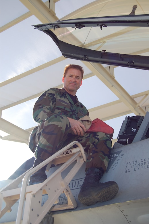 Staff Sgt. Jay Rosenberry prepares his F-16 for a sortie at Tucson International Airport. Sergeant Rosenberry was awarded the Coast Guard Silver Lifesaving medal for the heroic rescue of three young children caught in a riptide while vacationing in the Outer Banks of North Carolina in July 2006. The medal is awarded to any person who rescues or endeavors to rescue any other person from drowning, shipwreck or other perils of the water. (Air National Guard photo by Staff Sgt. Desiree Twombly)