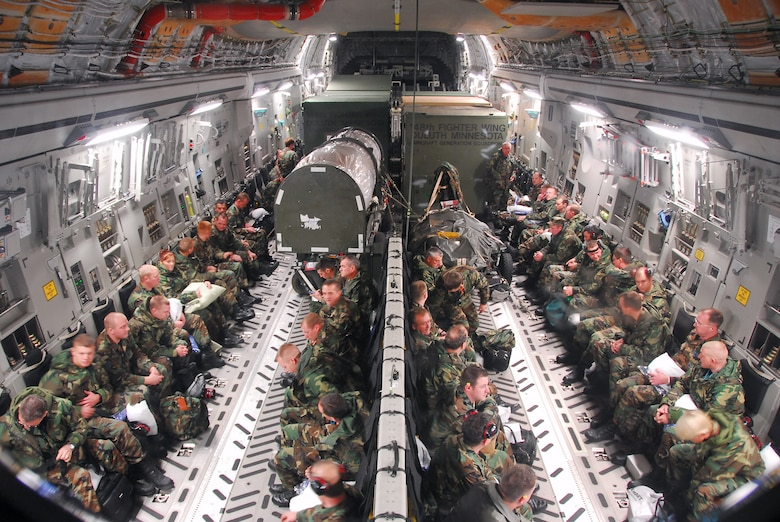Minnesota Air National Guard members of the 148th Fighter Wing await departure in a C-17 Globemaster prior to departing to Hickam Air Force Base, Hawaii, Nov. 9, 2007, at the Air National Guard Base located in Duluth, Minn. The 148th FW was selected by Occupational Health and Safety Administration officials for the Voluntary Protection Program Star Award. (U.S. Air Force photo/Tech. Sgt. Jason W. Rolfe)