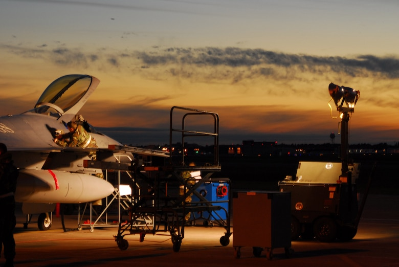 A member of the 148th Fighter Wing works on an F-16 Fighting Falcon during an October 2007 Operational Readiness Exercise in Duluth, Minn. The 148th FW was selected by Occupational Health and Safety Administration officials for the Voluntary Protection Program Star Award. (U.S. Air Force photo/Staff Sgt. Don Action)