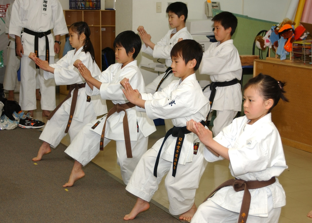 YOKOTA AIR BASE, Japan - Students from the Sho Yu Kan Dojo perform kata, karate forms, for students at the Yokota West Elementary School (YWES) during Nihon Matsuri 2008 Activity Day on May 6. Students from YWES got to see a number of traditional Japanese arts such as sumo, Ohayashi and judo. (U.S. Air Force photo by Airman 1st Class Jonathan Fowler)