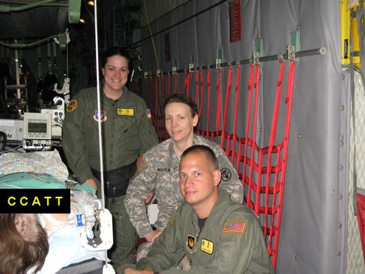 Maj. Sandra Wanke, Landstuhl Regional Medical Center surgeon (middle), Capt. Erika Dryzmalla, 435th Medical Squadron critical care nurse and Master Sgt. Timothy Carentz, 435th MDS, registered respiratory therapist transport a stabilized critically injured patient from Tel-Aviv, Israel, to Souda Bay, Greece, then on to Ramstein.and Landshuhl Regional Medical Center.(Courtesy photo)