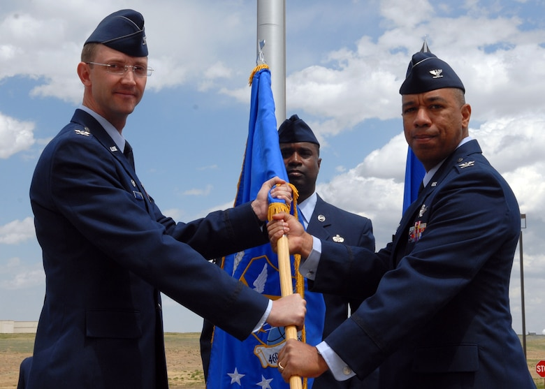 BUCKLEY AIR FORCE BASE, Colo. -- Col. Vincent Jefferson assumes command of the 460th Mission Support Group as Col. Wayne McGee, 460th Space Wing commander, presents him with the flag symbolizing the asumption of command. The ceremony took place here, May 9, in front of the Wing Headquarters Building. (U.S. Air Force photo by Senior Airman Michelle Lee Cross Furtado)