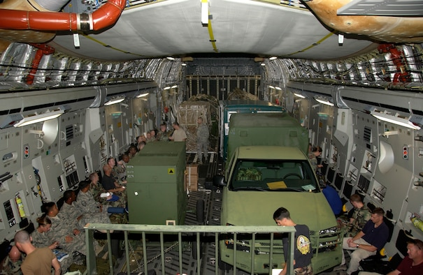 ANDERSEN AFB,GUAM -- Just under 50 members of the 36th Contingency Response Group settled into their seats in a crowded cargo section of the C-17 Globemaster III aircraft.  The personnel and equipment are heading to Thailand to stand ready to provide humanitarian aid to the people of Burma (Myanmar).  Units of all branches of the military are standing by, for an offical request from the Burma (Myanmar) government, to render aid to a country and people ravaged by massive flooding from