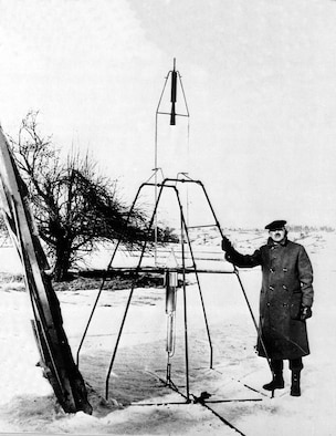 Goddard with the same 1926 rocket in its launch frame, Worcester, Mass. (U.S. Air Force photo)