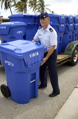 Col. Gregory Cain 36th Wing Vice Commander removes a new recycling bin straight from the truck when they were introduced May 5. The new recycling bins will be distributed to base housing occupants on a rotational basis. (U.S. Air Force photo by Airman 1st Class Carissa Wolff)