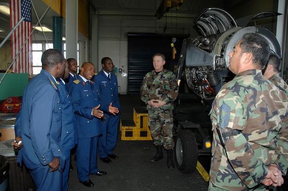 Group Captain Son Igwe, along with members of the Nigerian Air Force, met and toured with 129th Maintenance Group personnel during their visit to the 129th Rescue Wing, Moffett FAF, California Air National Guard. (U.S. Air Force photo/Master Sgt. Dan Kacir)
