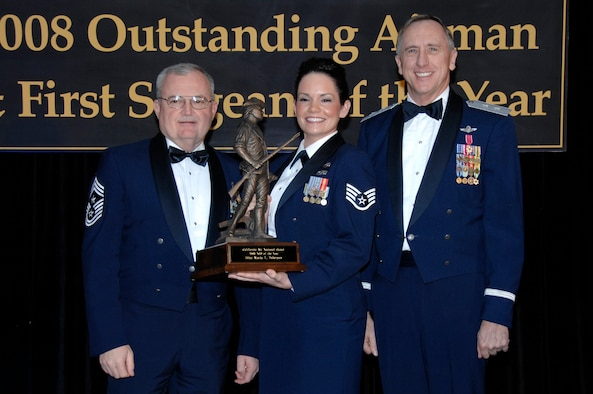 Staff Sgt. Maria Tubergen from the 129th Rescue Wing beams upon receipt of the California Air National Guard's Non-Commissioned Officer of the Year award.  She was presented with the award at the annual Outstanding Airman of the Year banquet in San Jose, Calif. Jan. 12 by Chief Master Sgt. Richard A. Smith. Command Chief Master Sergeant of the Air National Guard and Major Gen. Dennis Lucas, Commander of the California Air National Guard. (U.S. Air Force photo by Staff Sgt Andrew Hughan)