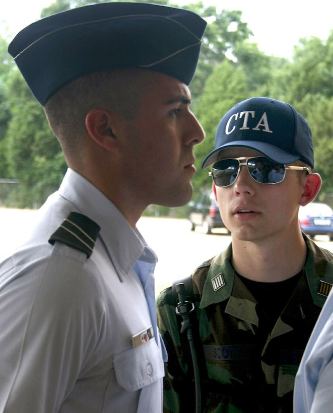 Cadet Gregory Scott (right) corrects a cadet during field training initial in-processing May 8 at Maxwell Air Force Base, Ala. More than 360 ROTC cadets, mostly rising juniors from 144 colleges nationwide, started off the first class of summer field training. Cadet Scott is a ROTC cadet training assistant from Utah's Brigham Young University. (U.S. Air Force photo/Staff Sgt. Jason Lake)
