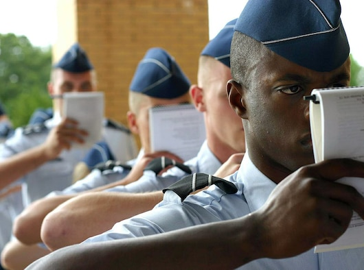 Cadet Tony Nelson (right) and other Air Force ROTC cadets study their training manuals while waiting to in-process summer field training May 8 at Maxwell Air Force Base, Ala. More than 360 ROTC cadets, mostly rising juniors from 144 colleges nationwide, started off the first class of summer field training. Cadet Nelson is from Det. 765, The Citadel -- The Military College of South Carolina. (U.S. Air Force photo/Staff Sgt. Jason Lake)