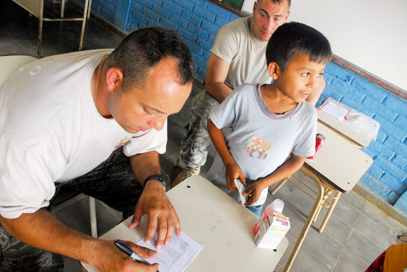 COMASAGUA, El Salvador ? Air Force Capt. Manny Silviera, reviews a prescription for a Salvadoran boy May 8 at a make-shift pharmacy at a school near Comasagua, El Salvador, during Fuerzas Aliadas Humanitarias 2008, the U.S. Southern Command and Salvadoran Ministry of Defense-sponsored exercise held throughout the Central American region May 5-15. During the exercise, medication valued at more than $10,000 was dispensed to Salvadorans in need. (U.S. Air Force photo by Tech. Sgt. William Farrow)