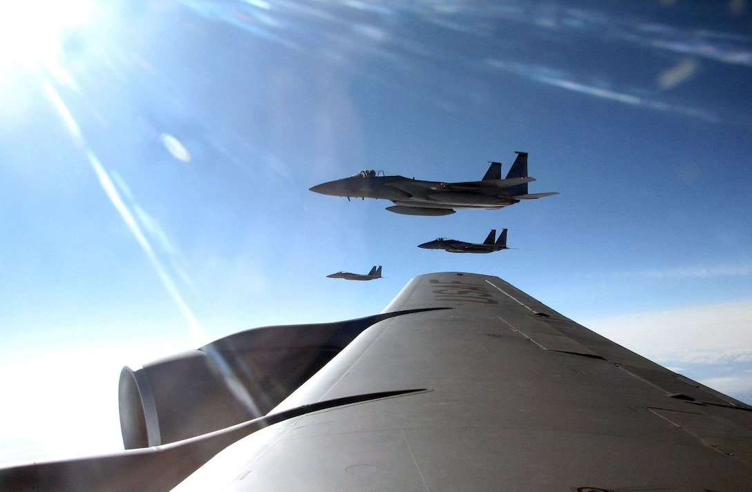 Three F-15 Eagles from the 18th Wing at Kadena Air Base, Japan, fly beside a KC-135 Stratotanker after refueling May 8 over Alaska. The aircraft are part of the more than 120 participating in Northern Edge 2008, the largest military training exercise in Alaska. Aircrews train in counter-air, close-air-support and air-interdiction missions. An Alaska Air National Guard KC-135, from Eielson Air Force Base's 168th Air Refueling Wing delivered the fuel during the mission. (U.S. Air Force photo/Tech. Sgt. Mikal Canfield)