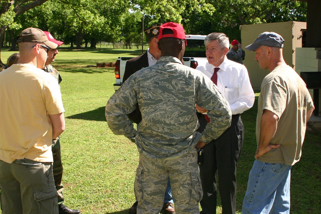 Secretary, Louisiana Department of Veterans Affairs, Lane A. Carson, speaks with members of the 307th Red Horse Squadron and 360th Chemical Army Guard Unit about veterans benefits during the welcome home picnic at Mike Woods Park in Bossier City, LA, Saturday, May 3, 2008. The event was arranged in part by Curley Huddleston and VFW Post 5951 for members of both units who recently returned from service in Iraq. (U.S. Air Force photo/Tech. Sgt. Jeffrey S. Walston)