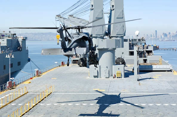An HH-60G Pave Hawk from the 129th Rescue Wing hovers over the USNS Algol as it hoists down pararescueman Tech. Sgt. Michael Bendle and a federal agent during a full-scale local exercise at Alameda Point, Calif. April 17. (U.S. Army photo by CW3 Jon-Nolan Paresa)