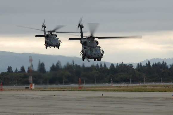 Two HH-60 Pave Hawk helicopters from the 129th Rescue Wing at Moffett Federal Airfield, Calif., take off for a night mission during an Operational Readiness Exercise. (U.S. Air Force photo by Master Sgt. Dan Kacir) (RELEASED)