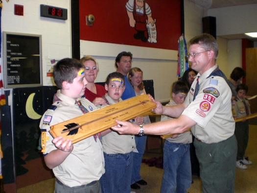 Pack 391 Cubmaster David Liszeski presents the Arrow of Light award to one of the members of his Pack during a recent meeting.  Lisenski was recently rescognized as the District Cubmaster of the Year by the Boy Scouts Will Rogers District. As an Air Force Reservists SMSgt. David Liszenski works for the 507th Civil Engineer Squadron, 507th Air Refueling Wing.