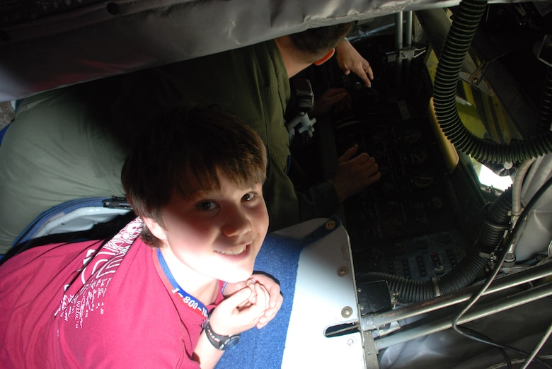 Nick Albrecht, 11, son of Tech Sgt. Robert Albrecht, 107th Airlift Wing, hangs out in the boom pod, of a KC-135R while 107th Airlift Wing boomer, Master Sgt. Raymond Fitzpatrick, describes his job.  Nick is attending a tour of the 107th?s aircraft during bring your kids to work day April 24.