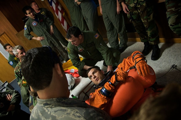 PATRICK AIR FORCE BASE, Fla. -- Pararescuemen from the 920th Rescue Wing conduct a pre-exercise briefing to become acquainted with floatation devices worn by NASA astronauts.  Members of the 920th RQW, along with a number of other military units, are participants in a Mode 8 emergency Space Shuttle astronaut bailout search and rescue exercise off the Florida coast.  Pararescuemen and crews from the 920th RQW support every Space Shuttle launch as part of a joint task force in case an emergency occurs. (U.S. Air Force photo/Tech. Sgt. Jeremy Allen)