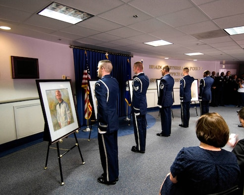 Portraits of Special Agents David Wieger, Nathan Schuldheiss, Thomas Crowell, Matthew Kuglics and Ryan Balmer are unveiled at the AFOSI Rotunda by the Andrews Air Force Base Honor Guard. (U.S. Air Force photo/Mike Hastings)