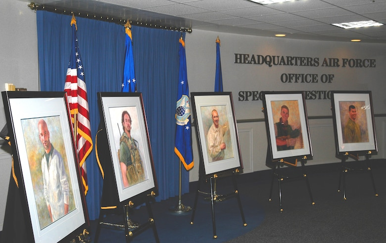 Portraits of Special Agents (l to r) David Wieger, Nathan Schuldheiss, Thomas Crowell,  Matthew Kuglics and Ryan Balmer are unveiled at the AFOSI Rotunda (U.S. Air Force photo/Tech. Sgt. John Jung)