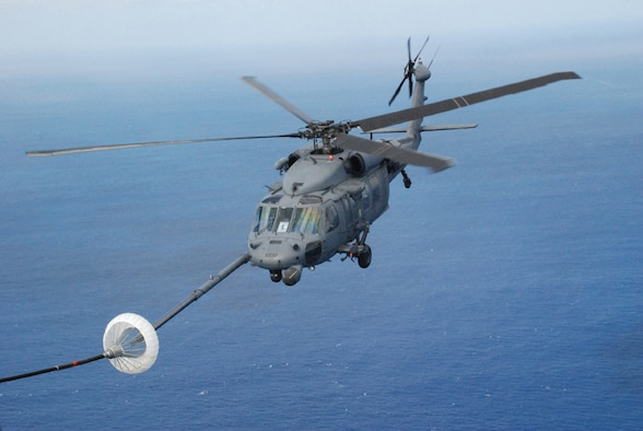 PATRICK AIR FORCE BASE, Fla. -- A HH-60G Pave Hawk helicopter from the 920th Rescue Wing hooks up to the drogue on a HC-130P/N aircraft during mid-air refueling operations.  Both aircraft were participating in a Mode 8 astronaut bailout search and rescue exercise. Air Force active duty, guard, and reserve units, along with Navy, Coast Guard and National Aeronautics Space Administration organizations, participated in the exercise which was held off the Florida coast.  (U.S. Air Force photo/Capt. Cathleen Snow)