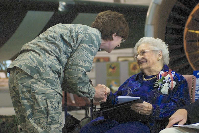 Lt. Col. Marcia Potter, 436th Medical Group chief nurse, presents Dorothy Lewis with the Nurse's coin of the U.S. Air Force during the ceremony May 9 at the Air Mobility Command Museum. (U.S. Air Force photo/Roland Balik)