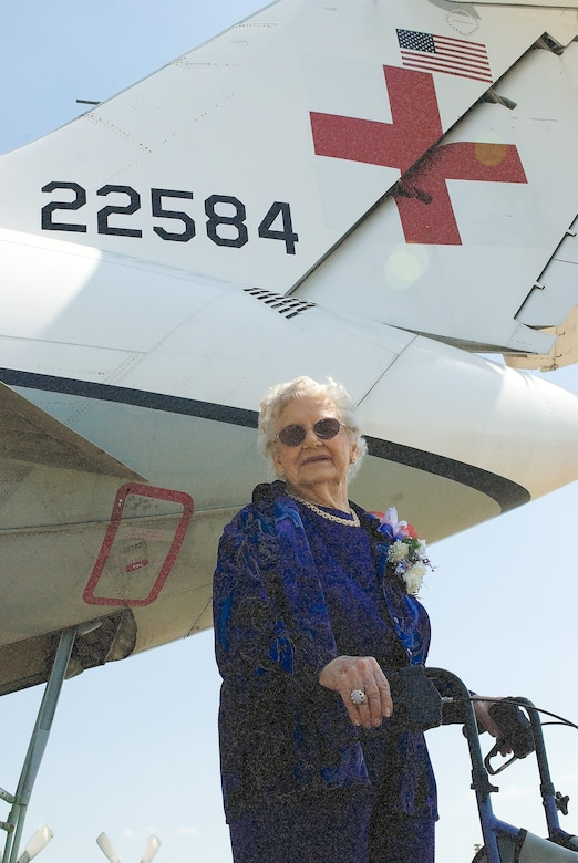 Dorothy Lewis visits a C-9A Nightingale outside the Air Mobility Command Museum. The AMC Museum honored this 92-year-old heroine for donating her dress uniform and bronze star during a ceremony May 9. (U.S. Air Force photo/Roland Balik)