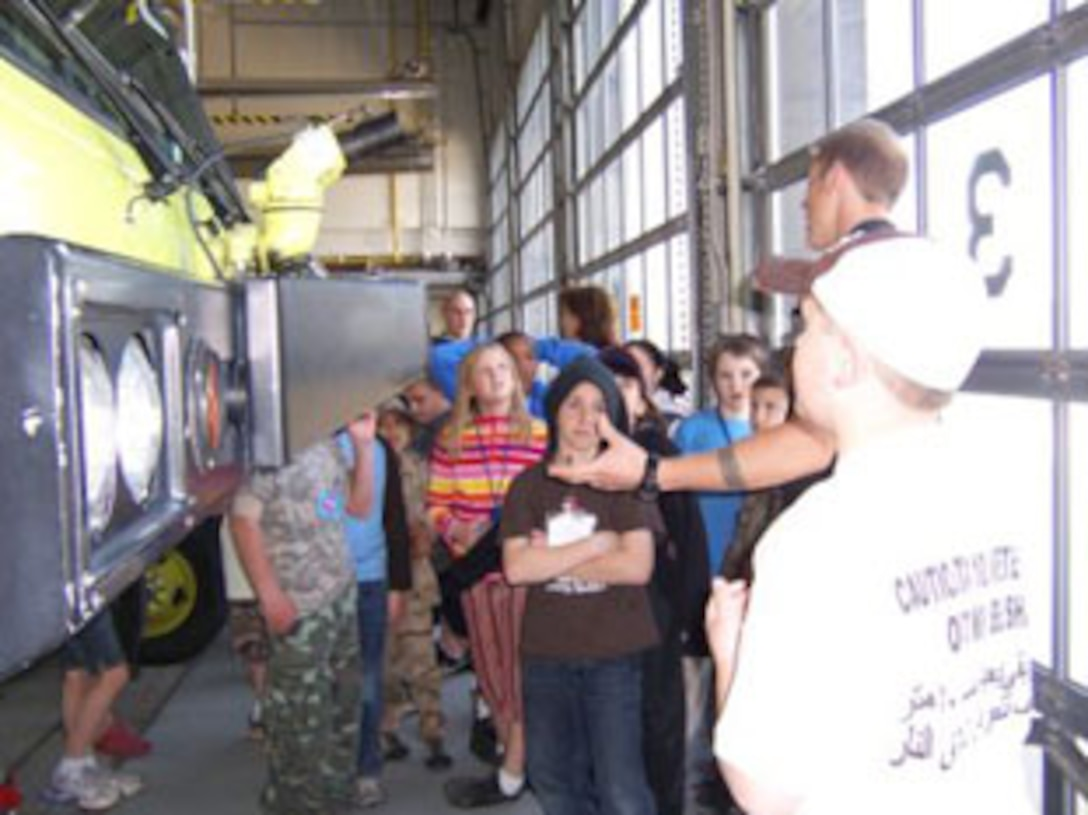 SSgt. Nolan P. Mooney, 174th Fighter Wing Fire Protection Apprentice shows the  discusses the fire trucks