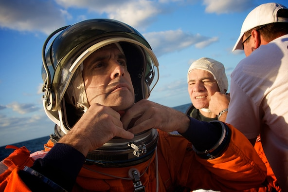 PATRICK AIR FORCE BASE, Fla. -- Astronauts Rick Mastracchio, front, and Paolo Angelo Nespoli, don their flight suits just before being dropped into the Atlantic Ocean to await rescue by Air Force Reserve pararescuemen from the 920th Rescue Wing during an annual search and rescue exercise.  Members of the 920th RQW are part of a joint task force that supports Space Shuttle launches and are always ready in the event of an emergency. (U.S. Air Force photo/Tech. Sgt. Jeremy Allen)