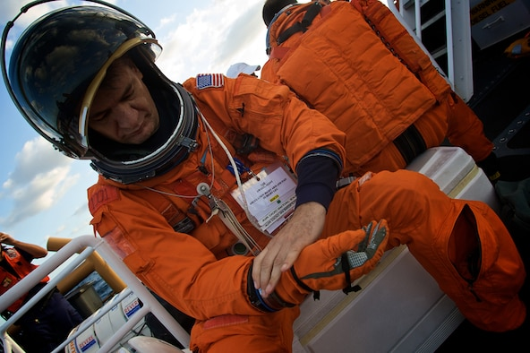PATRICK AIR FORCE BASE, Fla.--  NASA astronaut Paolo Angelo Nespoli secures his gloves May 14, 2008 just before dropping into the chilly waters of Atlantic Ocean two miles off Florida's east coast.  Air Force Reserve pararescuemen from the 920th Rescue Wing quickly located Nespoli and hoisted him into their rescue helicopter during this annual training exercise.  Members of the 920th RQW are part of a joint task force that supports Space Shuttle launches and are always ready in the event of an emergency. (U.S. Air Force photo/Tech. Sgt. Jeremy Allen)