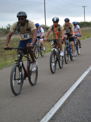From left to right, 1st Lt. Brian Williams, Senior Airman Kamaile Chan, 2nd Lt. Joel Hansen and Col. Merrily Madero, Goodfellow Ninjas team members, complete the biking leg of the Laughlin Adventure Race April 26. (U.S. Air Force photo by Senior Airman Julio Brito)