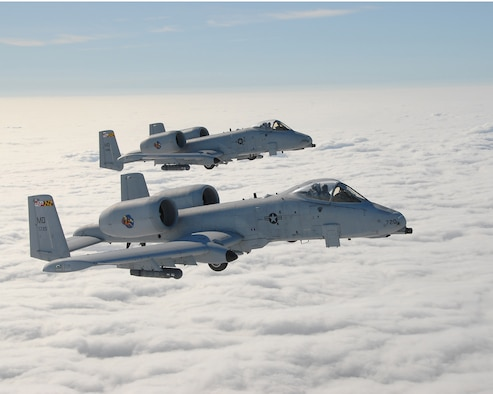 Two A-10C attack jets of the Maryland Air National Guard's 104th Fighter Squadron fly a training mission over Maryland's Eastern Shore, Jun. 14, 2007  (Photo by Senior Master Sgt. Jim Foard).
