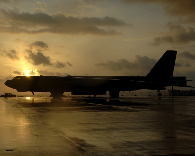 The sun rises over a B-52 Stratofortress Bomber assigned to the 96th Expeditionary Bomb Squadron May 15. The Bombers are deployed from Barksdale AFB, La. to provide the U.S. Pacific Command commander a continuous bomber presence in the Asia-Pacific region. (U.S. Air Force Photo by Airman 1st Class Cory Todd)