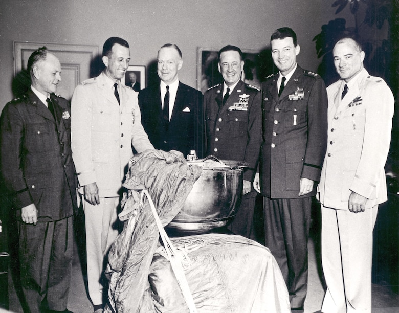Gen. Schriever and colleagues with Discoverer XIII, one of the first successful U.S. reconnaissance satellites and an early triumph of Air Force space technology. (U.S. Air Force photo)
