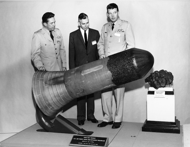 Gen. Schriever (right) inspects an experimental missile warhead reentry vehicle in 1959. Creating an effective nuclear-armed missile force was one of his main goals. (U.S. Air Force photo)