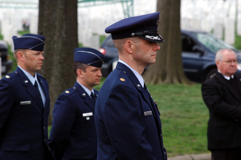 Maj. Phil Heseltine, U.S. Air Force Expeditionary Center executive officer to the commander, Fort Dix, N.J., participates in the funeral for Air Force Maj. Robert F. Woods April 9, 2008, at Arlington National Cemetery, Va.  Earlier that day, Major Heseltine presented POW/MIA bracelet to the family of Major Woods, whose name is on the bracelet that Major Heseltine wore for 18 years.  (U.S. Air Force Photo/Tech. Sgt. Scott T. Sturkol)