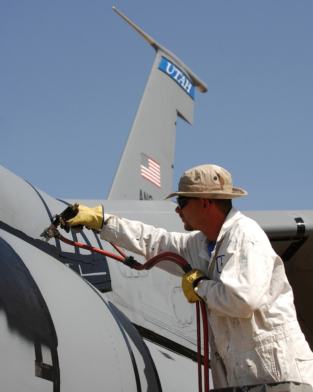 Sam Wilkins, a spray-lat technician with the 578th Storage and Disposal Squadron at Davis Monthan Air Force Base, prepares an Air Force KC-135 E-model aircraft for preservation and storage. The 50-year-old aircraft was delivered to the group for long-term storage at the 2,600 acre facility after serving with the 151st Air Refueling Wing, Utah Air National Guard for more than 20 years. U.S. Air Force photo by: Master Sgt. Burke Baker
