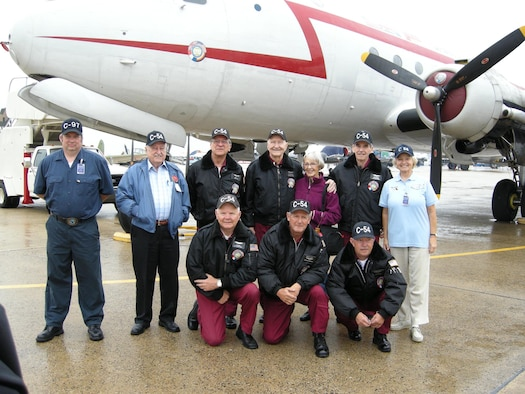 "ANDREWS AIR FORCE BASE, Md. -- Members of the the Berlin Airlift Historical Foundation pose with Retired Col. Gail Halvorsen (center) and his wife Lorraine (third from right) at the Joint Service Open House here May 18. Colonel Halvorsen earned the nickname the ""Candy Bomber"" for dropping more than 20 tons of candy to local children in Berlin, Germany, between 1948 and 1949.  The BAHF stands before the C-54E transport aircraft dubbed, ""The Spirit of Freedom."" The foundation is dedicated to preserving the memory and legacy of a key humanitarian and aviation historical event, The Berlin Airlift. (U.S. Air Force photo/Staff Sgt. Amaani Lyle)"