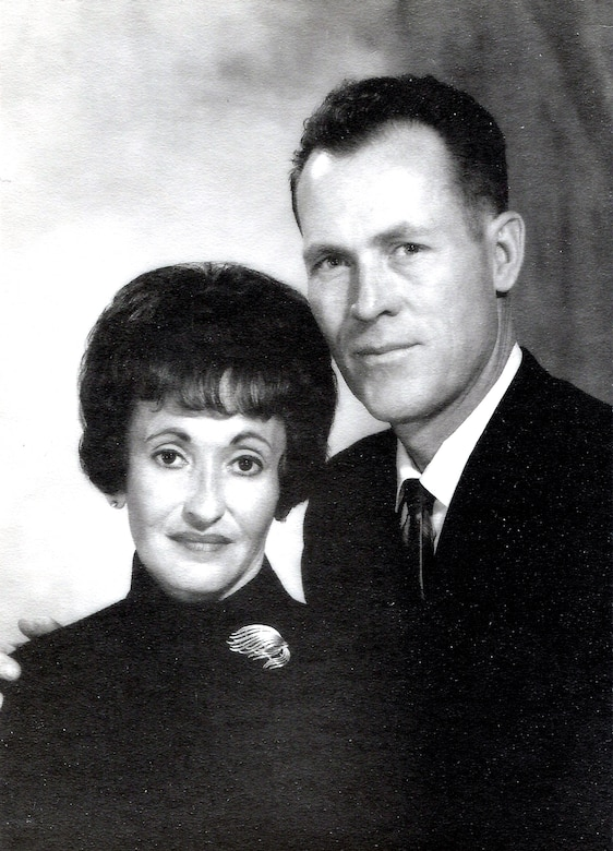 This portrait of Mary and Maj. Robert F. Woods was taken just months before Major Woods left for Vietnam in 1967. On Nov. 30, 2007, the Air Force announced that Major Woods, along with co-pilot Capt. Johnnie C. Cornelius, were identified and their remains returned to the United States from Vietnam.  On June 26, 1968, Major Woods and Captain Cornelius were flying a visual reconaissance mission over Quang Binh Province, Vietnam, when their O-2A Skymaster aircraft crashed in a remote mountainous area.  Major Woods was buried with full military honors April 9, 2008, at Arlington National Cemetery nearly 40 years after he disappeared in the crash. (Photo courtesy of the Woods family)