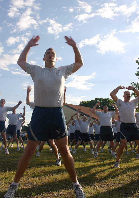 Chief Master Sgt. John Harrison (left) counts out loud as he performs jumping jacks with his peers during the first event of the Senior Enlisted Leader Summit May 18 at Maxwell Air Force Base's Gunter Annex in Alabama. More than 350 command chief master sergeants, career field managers, professional military education commandants and other key senior enlisted leaders kicked off the 2008 Senior Enlisted Leader Summit with a 2.2-mile formation run at Maxwell's Gunter Annex. Chief Harrison is assigned to the Air Force Inspection Agency at Kirtland Air Force Base, N.M. (U.S. Air Force photo/Staff Sgt. Jason Lake)