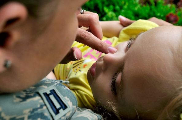 SCOTT AIR FORCE BASE, Ill. -- Capt. Kerri Rochman, 375th Mission Support Squadron chief of career development, spends some quiet time on the porch with her 3 1/2 year old daughter Elise on May 19. Elise was diagnosed more than two years ago with Tays-Sachs disease, an inherited incurable disease of the central nervous system. (U.S. Air Force photo/Master Sgt. Maurice Hessel)