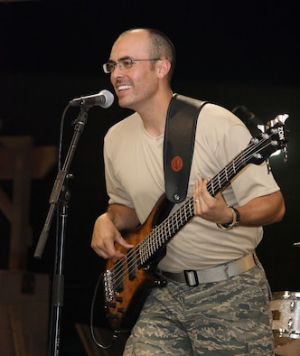 SOUTHWEST ASIA -- Senior Airman David Beasley, a bass guitar player with the U.S. Air Force Central Command Band called Falcon throws down a jam leaving the audience applauding for more during a May 15, 2008 performance at an air base in the Persian Gulf Region.  The Falcon Band recently kicked off a 60-day tour throughout Southwest Asia and the Horn of Africa to positively promote troop morale, diplomacy and outreach to host nation communities. (U.S. Air Force photo/Master Sgt. Michael Miller)
